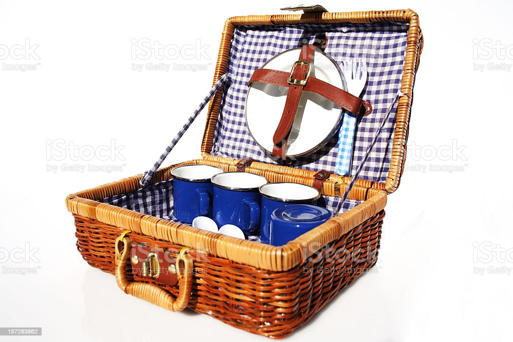 A picnic basket made of wicker and blue dishes stock photo
