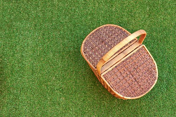 Picnic Basket On The Fresh Grass Overhead View stock photo