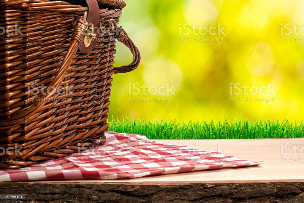 Picnic basket on the table stock photo