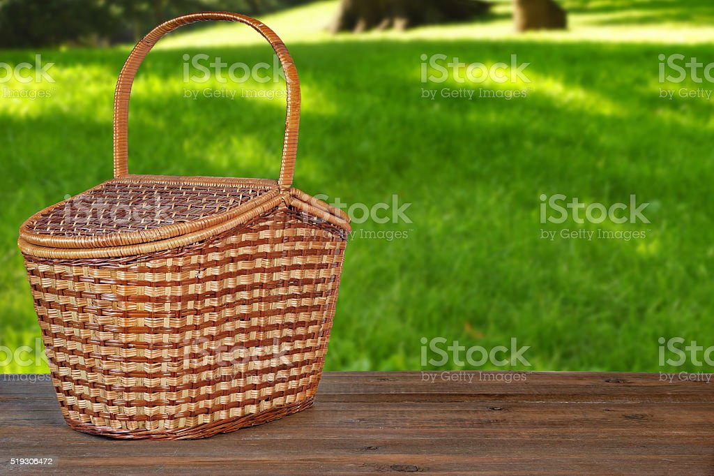 Marvelous Picnic Basket Or Hamper On Wooden Bench In Garden Stock Creativecarmelina Interior Chair Design Creativecarmelinacom