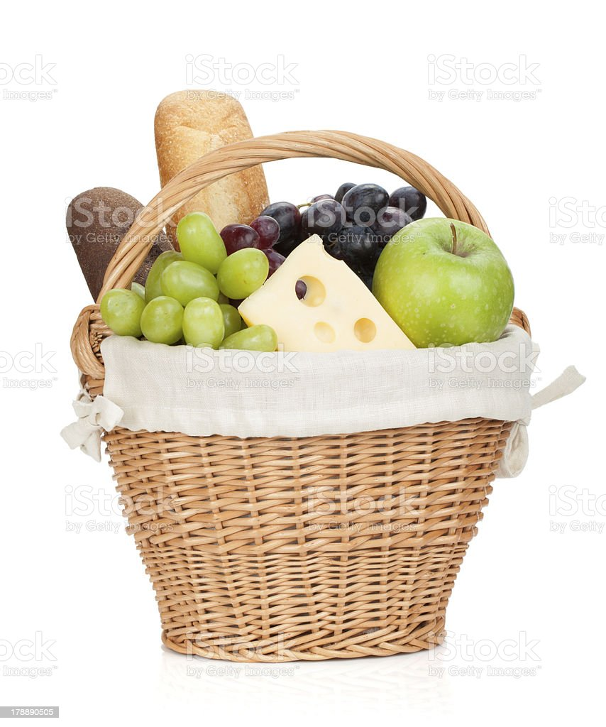Picnic basket with bread and fruits royalty-free stock photo