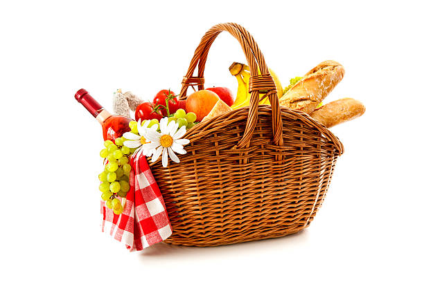 picnic basket with fruit bread and wine stock photo
