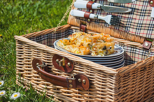 Picnic basket with served meat and cheese pie stock photo