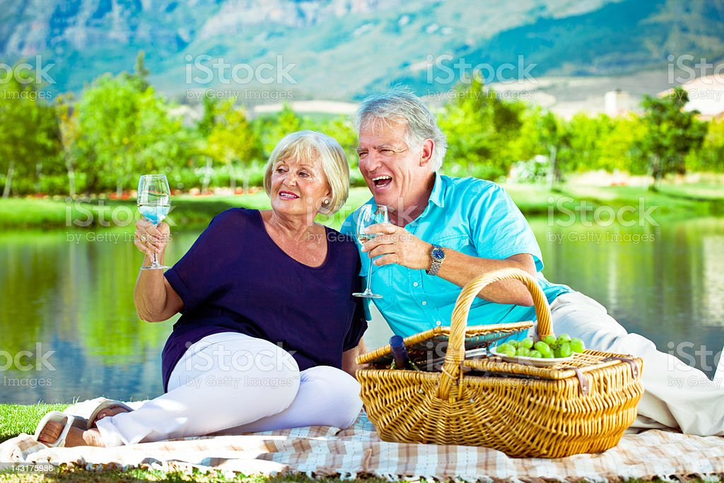 Picnic by the lake  65-69 Years Stock Photo