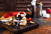 istock Picnic dessert smores with marshmallow, graham crackers, strawberry and chocolate sauce 801239484