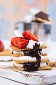 istock Picnic dessert smores with marshmallow, graham crackers, strawberry and chocolate sauce 801239596
