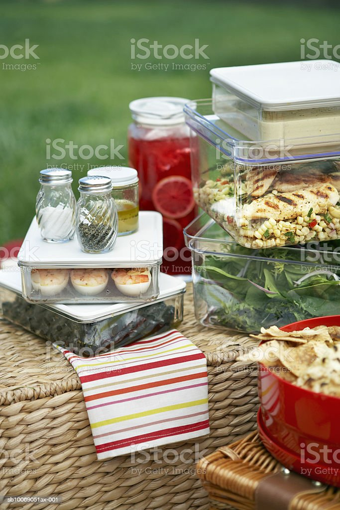 Picnic foods in containers on picnic baskets, close-up, elevated view royalty-free stock photo
