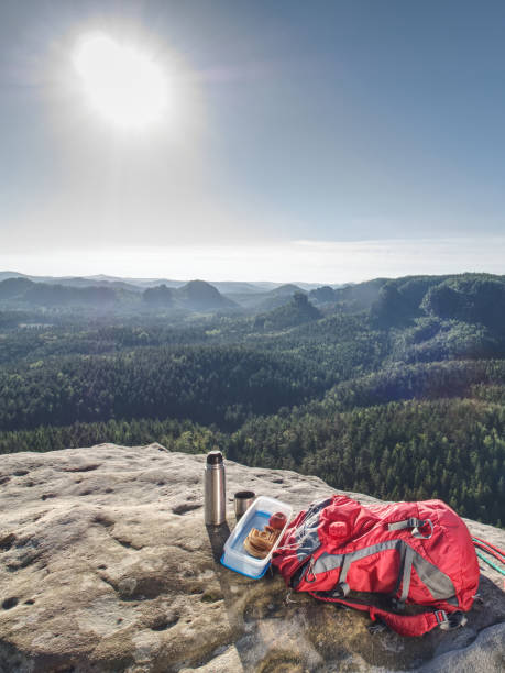 Picnic of tea and sandwich on rock. Resting for lunch i stock photo