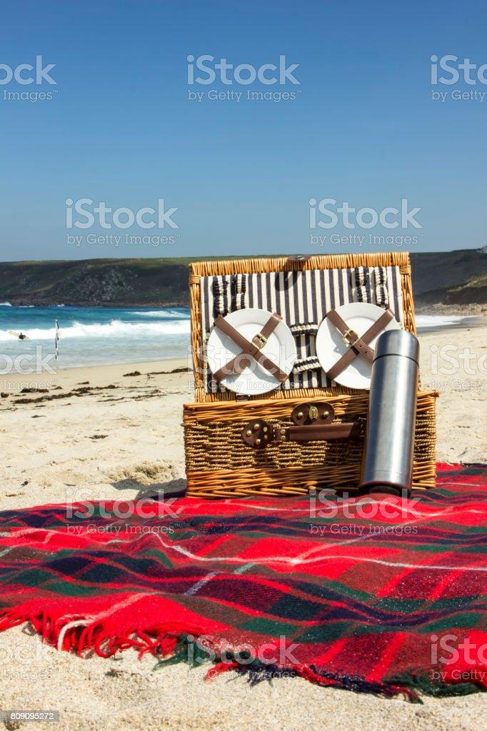 Picnic on an empty beach stock photo