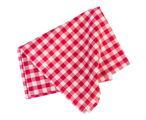 Picnic red cloth isolated. Checkered gigham folded red picnic cloth isolated. plaid stock pictures, royalty-free photos & images