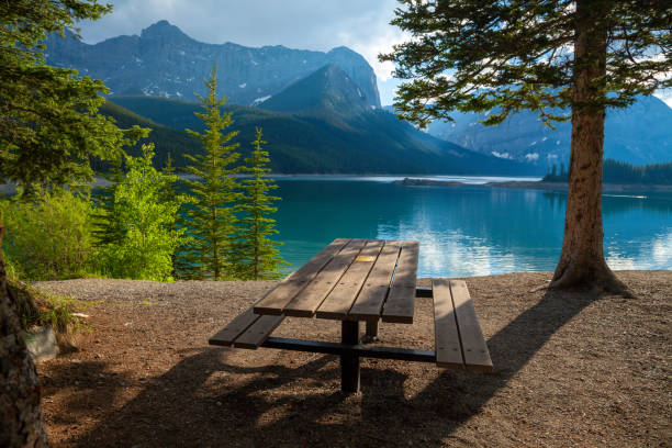 A picnic site at Upper Kananaskis Lake in the Canadian Rocky Mountains A picnic site at Upper Kananaskis Lake in the Canadian Rocky Mountains, Alberta, Canada kananaskis country stock pictures, royalty-free photos & images