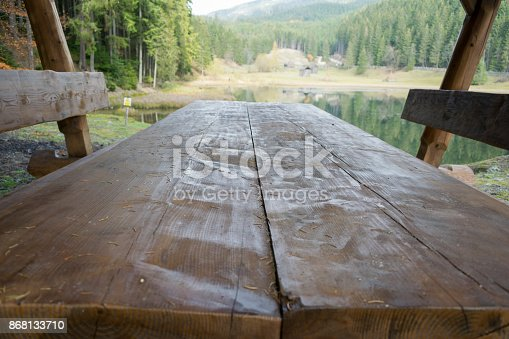 wooden table and chairs for tourists