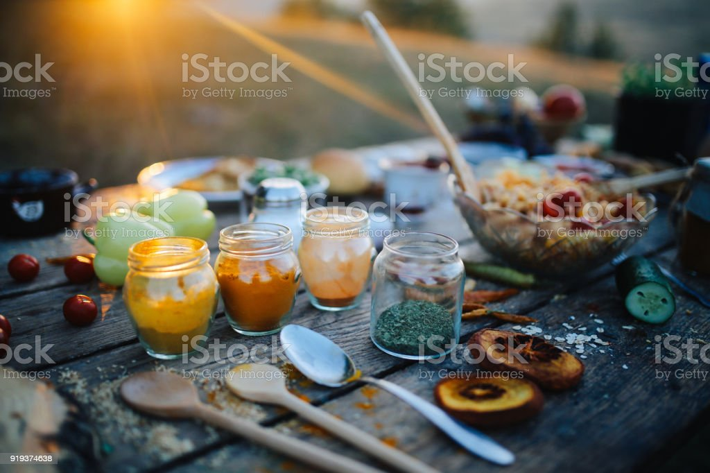 Vintage toned image of various food on the old wooden table in...