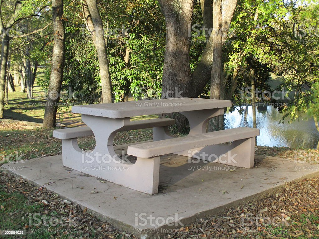 Picnic Table Near a Pond in a Park stock photo