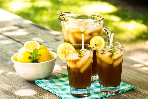 Picnic Table With Cold Iced Tea And Lemons stock photo
