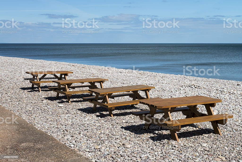 Picnic Tables on the Beach stock photo