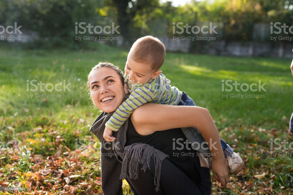 Picnic time A young mother plays with her young son during a picnic in the fall 12-17 Months Stock Photo