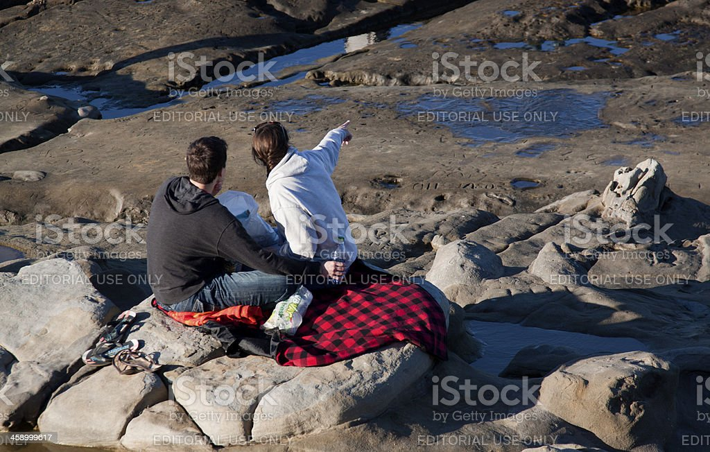Picnicing Couple on the Rocks royalty-free stock photo