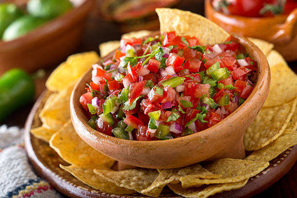 Salsa Pico De Gallo A delicious home made salsa pico de gallo with tomato, red onion, lime, cilantro, and jalapeno pepper. salsa sauce stock pictures, royalty-free photos & images