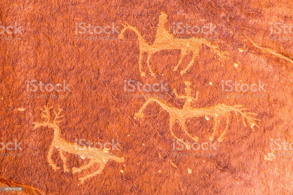 Pictographs of riders on horseback, Canyon de Chelly, Arizona, USA stock photo