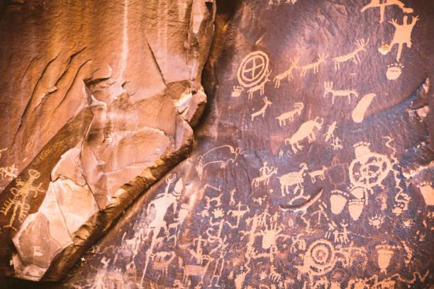 pictographs on a rock wall panel near Moab Utah stock photo