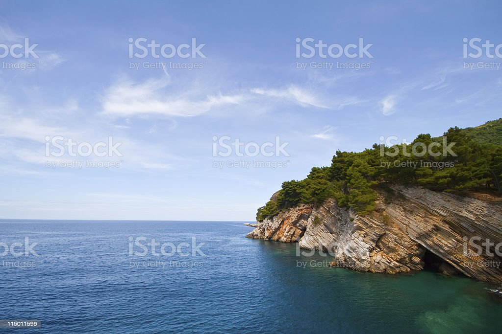 Pictorial blue Adriatic sea with rocks stock photo