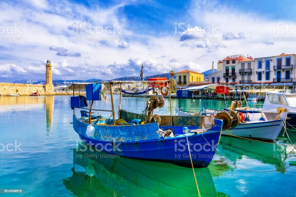 Pictorial colorful Greece series - Rethymnon with old lighthouse and boats, Crete stock photo
