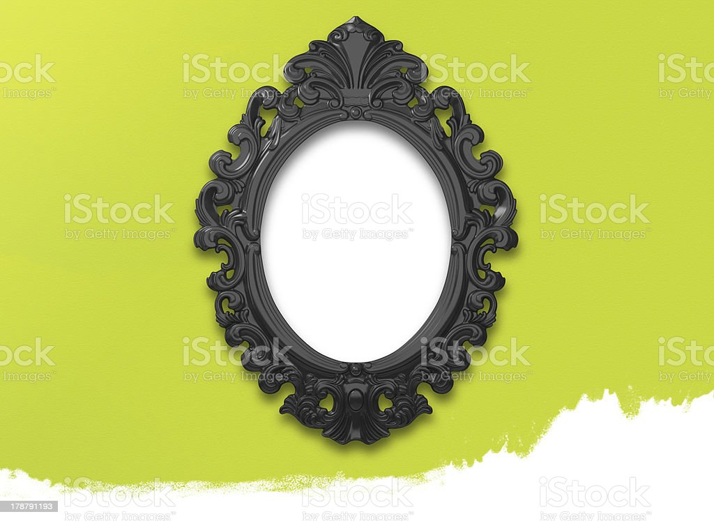Picture Frame Black Oval Circle on green wall royalty-free stock photo