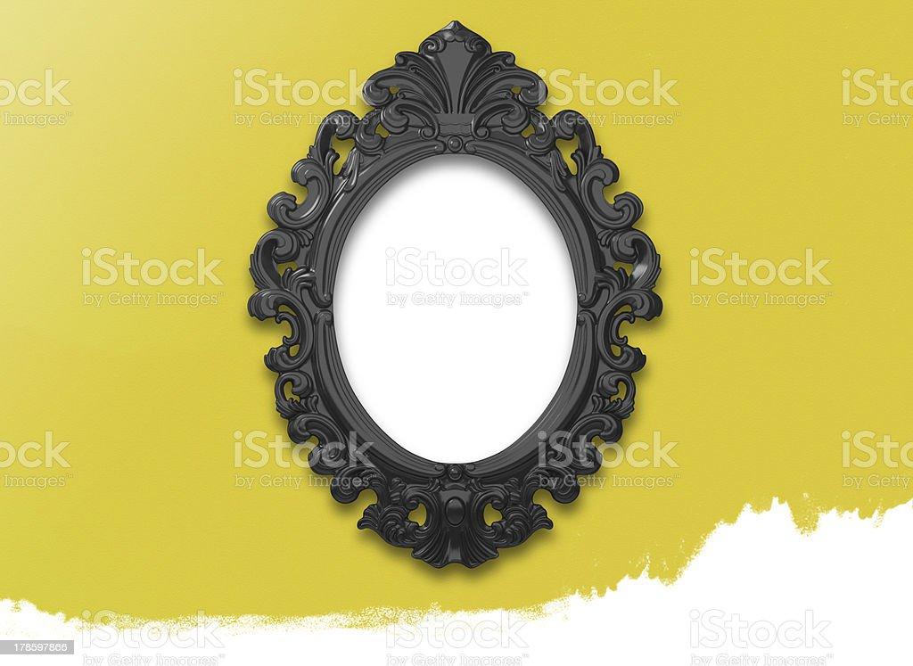 Picture Frame Black Oval Circle on yellow wall. stock photo