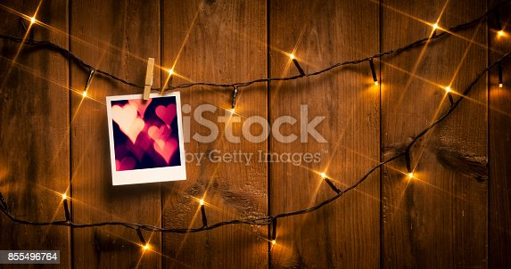 istock Picture Frame on wood and lights 855496764