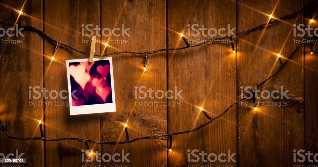 Picture Frame on wood and lights stock photo