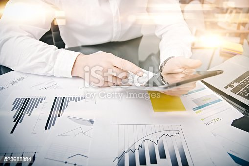 533699494istockphoto Picture man touching modern tablet screen.Trader manager working new 523688884
