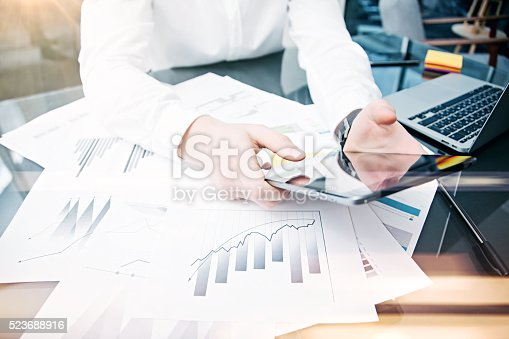 533699494istockphoto Picture man touching modern tablet screen.Trader manager working new 523688916