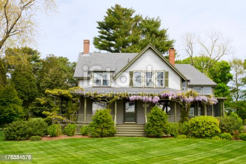 A beautiful country home in the Queen Anne style of greek revival architecture near Cape Cod in New England.