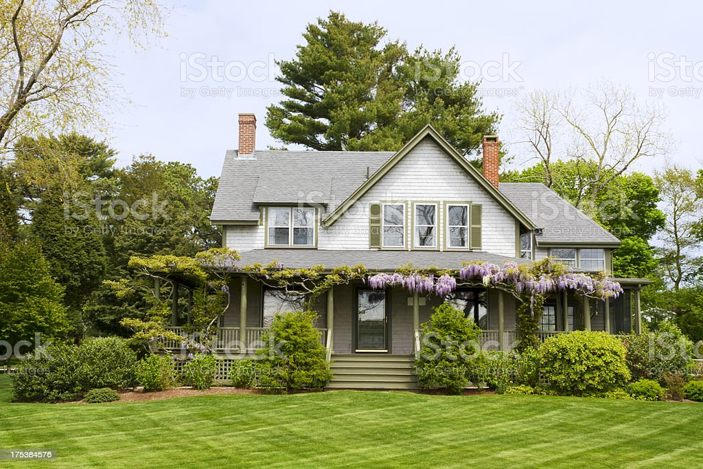 A picture of a big home with a green yard stock photo