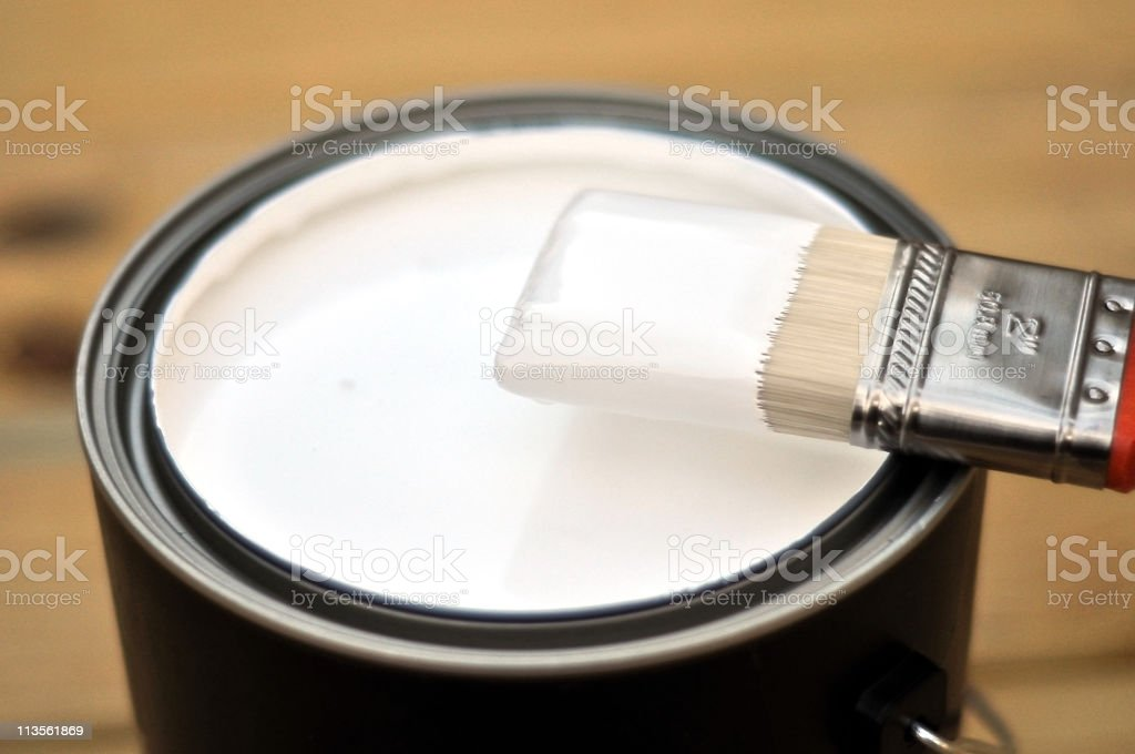 A picture of a black bucket with white paint in it royalty-free stock photo