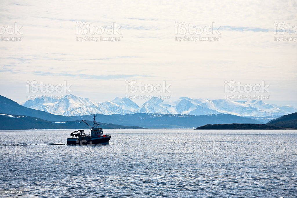 A picture of a boat in the middle of the sea stock photo