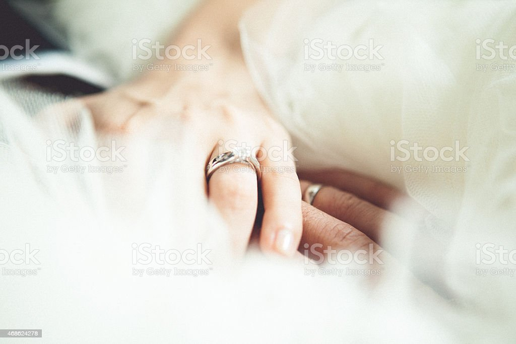 A picture of a bride and groom holding hands stock photo