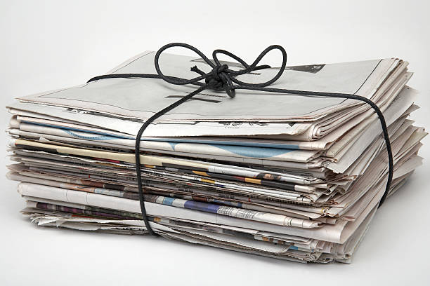 A picture of a bundle of newspapers Newspapers tied up with string and ready for recycling bundle stock pictures, royalty-free photos & images