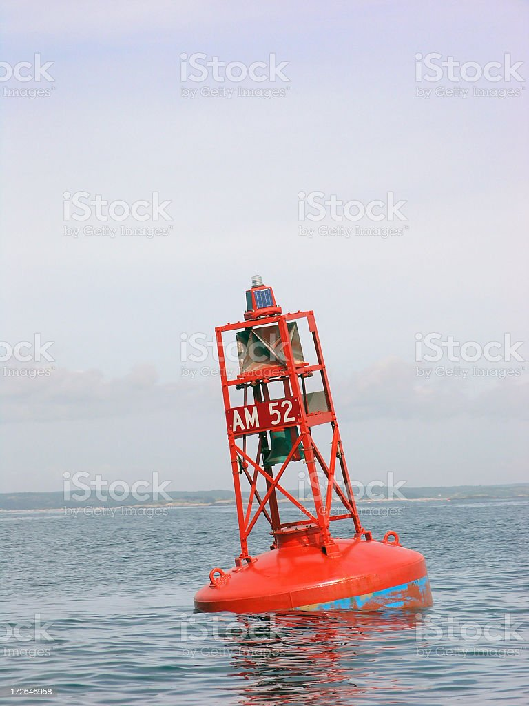 A picture of a buoy in the middle of the ocean stock photo