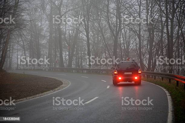 Photo of Picture of a car on the road on a gray day