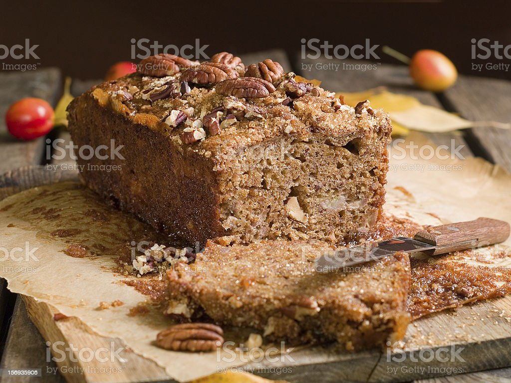 Picture of a chocolate cake with some nuts on top stock photo