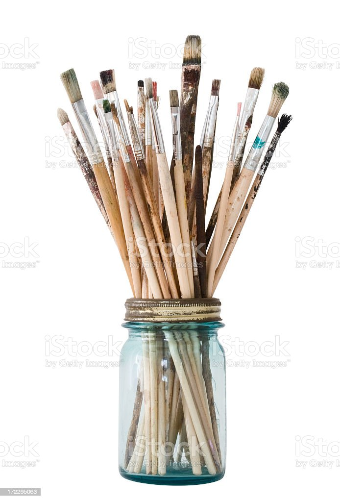 Picture of a clear jar filled with paint brushes stock photo