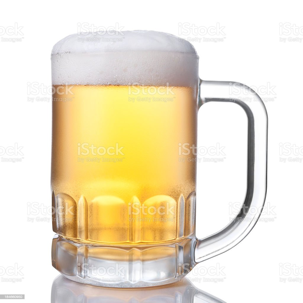 A picture of a cup full of beer royalty-free stock photo