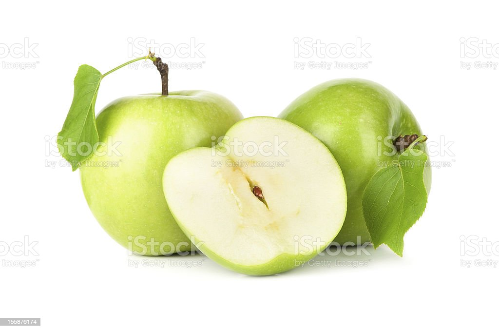 A picture of a cut apple and two whole ones stock photo