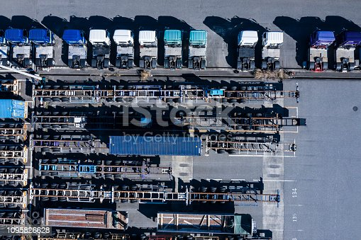 1142724396 istock photo Picture of a factory where transportation trucks are lining up 1095826628
