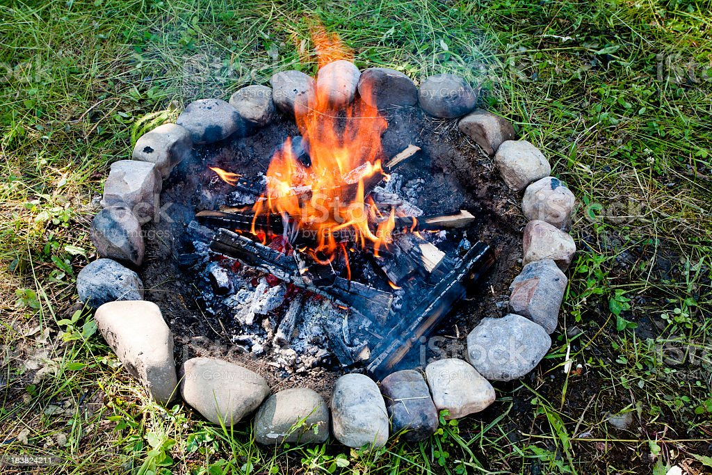 Picture of a fire on a camp with smoke royalty-free stock photo