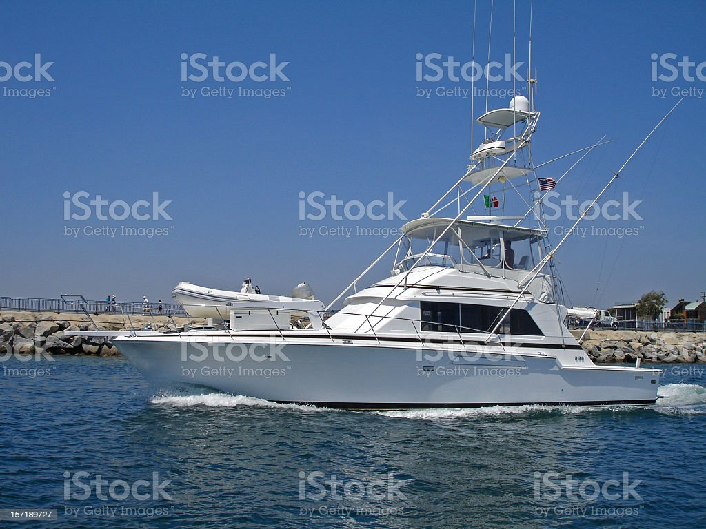 A picture of a fishing boat in the water stock photo