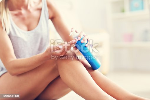 istock Picture of a fit woman holding lotion over her legs 655641208