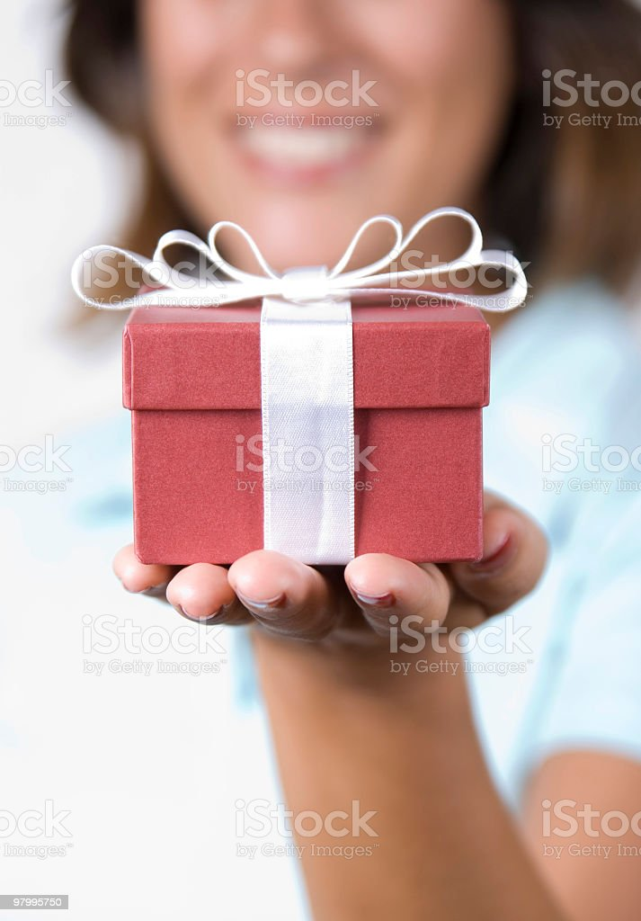 A picture of a girl holding a gift in her hand royalty-free stock photo
